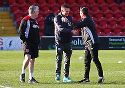 Leicester City's Jamie Vardy with members of the Fleetwood backroom staff on the pitch before the FA Cup, third round match at Highbury Stadium, Fleetwood