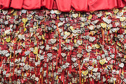 Chinese Love charms covering the temple's wall at the Dujiangyan city temple building at the irrigation site, China, Sichuan Province