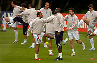 Photo: Richard Lane.<br />England Training Session. 22/05/2006.<br />Ashley Cole (L) and Sol Campbell help each other stretch.