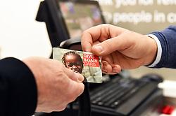 Give & Gain loyalty card, British Red Cross charity shop, UK