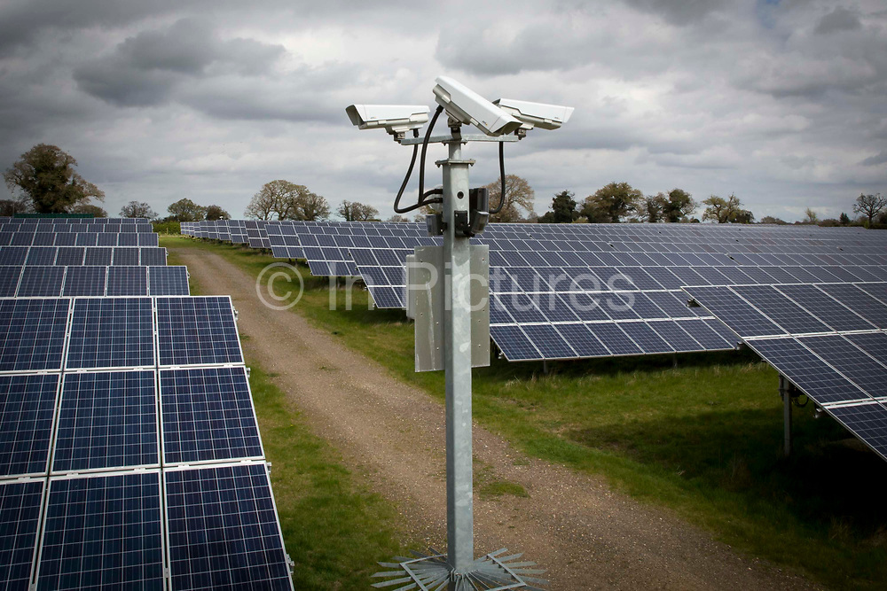 Security cameras watch for anything unusual going on at Salhouse Solar Park that has an electrical output of 4.987 MW saving emissions of 4890 tonnes of C02 per year. Norfolk. UK.