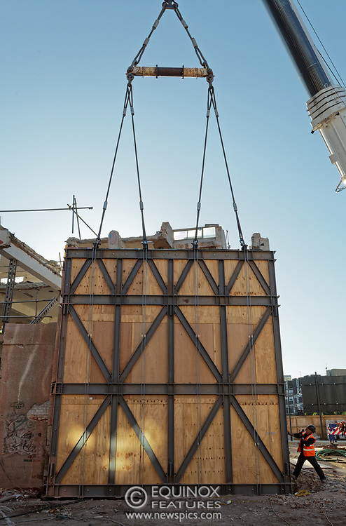 London, United Kingdom - 20 September 2019<br /> EXCLUSIVE SET - Aerial construction specialists and demolition experts use a huge crane to carefully lift intact, a twenty five ton, two-story wall, to preserve a famous Banksy rat image which has been covered up for years. Teams from specialist companies have spent over six weeks cutting around the artwork and fitting custom made eight ton steel supports to enable them to save the historic piece of art. Work has started on the construction of a new twenty seven floor art'otel hotel on the site of the old Foundry building in Shoreditch, east London, and a condition of the planning permission was to preserve the historical Banksy graffiti. A second section of the painting, an image of a TV being thrown through a broken window has already been cut out and moved separately. After the hotel construction is complete the two parts of the Banksy painting will be displayed on the hotel. Our pictures show the stages of work to protect the image, culminating in the lifting of the three story wall by crane. Video footage also available.<br /> (photo by: EQUINOXFEATURES.COM)<br /> Picture Data:<br /> Photographer: Equinox Features<br /> Copyright: ©2019 Equinox Licensing Ltd. +443700 780000<br /> Contact: Equinox Features<br /> Date Taken: 20190920<br /> Time Taken: 17085758<br /> www.newspics.com