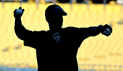 September 7, 2017 - Los Angeles, California, U.S. - Colorado Rockies batting practice pitcher is silhouetted prior to a Major League baseball game against the Los Angeles Dodgers at Dodger Stadium on Thursday, Sept. 07, 2017 in Los Angeles. (Photo by Keith Birmingham, Pasadena Star-News/SCNG) (Credit Image: © San Gabriel Valley Tribune via ZUMA Wire)