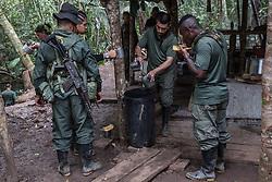 El Diamante, Meta, Colombia - 16.09.2016        <br /> <br /> Guerilla camp during the 10th conference of the marxist FARC-EP in El Diamante, a Guerilla controlled area in the Colombian district Meta. Few days ahead of the peace contract passing after 52 years of war with the Colombian Governement wants the FARC decide on the 7-days long conferce their transformation into a unarmed political organization. <br /> <br /> Guerilla-Camps zur zehnten Konferenz der marxistischen FARC-EP in El Diamante, einem von der Guerilla kontrollierten Gebiet im kolumbianischen Region Meta. Wenige Tage vor der geplanten Verabschiedung eines Friedensvertrags nach 52 Jahren Krieg mit der kolumbianischen Regierung will die FARC auf ihrer sieben taegigen Konferenz die Umwandlung in eine unbewaffneten politischen Organisation beschlieflen. <br />  <br /> Photo: Bjoern Kietzmann
