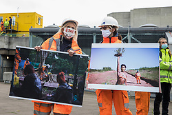 London, UK. 30th October, 2020. Activists dressed as HS2 workers take part in a HS2 Chainsaw Massacre protest outside the Among The Trees exhibition at the Hayward Gallery. The protest was intended to highlight deforestation, including the daily environmental destruction being wrought for the controversial HS2 high-speed rail project, and instances of violence and brutality by security guards and bailiffs working on behalf of HS2 Ltd.