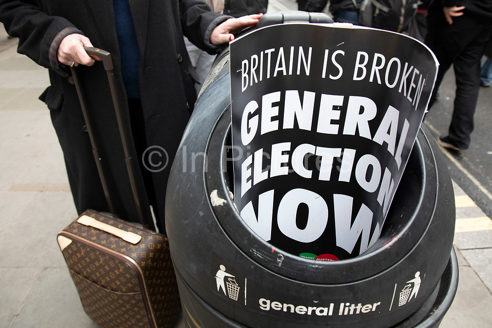 Britain is Broken - General Election Now demonstration against Tory cuts and austerity on 12th January 2019 in London, United Kingdom. Irrespective of which way people voted in the EU referendum, this protest was calling for an end to austerity and homelessness, the nationalisation of rail and other utilities, and ultimately, for a general election to end the Tories power. Placard in the rubbish bin.