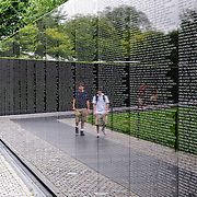 Names of those killed in action in Vietnam on the wall of the Vietnam Memorial in Washington DC.