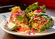 Lotus Cafe offers a wide array of raw-food choices, like this  swiss chard wrap with lemon-herb sunflower seed pate and a side of turnip noodle raw pad thai.