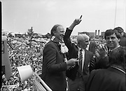 Irish Soccer Team Welcomed Home.   (R81)..1988..19.06.1988..06.19.1988..19th June 1988..After their great success in Germany in Euro 88, the Irish soccer team had a triumphant homecoming. An Taoiseach, Charles Haughey TD and his government were to the forefront of the welcome. Thousands of fans thronged the airport and all the approach roads in the hope of seeing the team. The full squad is as follows..1.GK.Packie Bonner. Celtic.2.DF.Chris Morris. Celtic.3.DF.Chris Hughton  Tottenham Hotspur.4.DF.Mick McCarthy. Celtic.5.DF.Kevin Moran. Manchester United.6.MF.Ronnie Whelan. Liverpool.7.MF.Paul McGrath. Manchester United.8.MF.Ray Houghton. Liverpool.9.FW.John Aldridge. Liverpool.10.FW.Frank Stapleton Derby County.11.MF.Tony Galvin. Sheffield Wednesday.12.FW.Tony Cascarino. Millwall.13.MF.Liam O'Brien. Manchester United.14.FW.David Kelly. Walsall.15.MF.Kevin Sheedy. Everton.16.GK.Gerry Peyton. Bournemouth.17.FW.John Byrne. Le Havre.18.FW.John Sheridan. Leeds United.19.DF.John Anderson. Newcastle United.20.FW.Niall Quinn. Arsenal..Jack Charlton is pictured taking his place aboard the bus prior to the drive to Dublin city centre.Mick Byrne salutes the crowd.