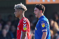 AFC Wimbledon defender Will Nightingale (5) talking to Charlton Athletic attacker Lyle Taylor (9) during the EFL Sky Bet League 1 match between AFC Wimbledon and Charlton Athletic at the Cherry Red Records Stadium, Kingston, England on 23 February 2019.