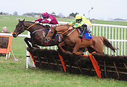 Moratorium ridden by Jack Kennedy (left) beats Getaway John ridden by JJ Slevin to win the Horse & Jockey Rated Novice Hurdle at Thurles Racecourse.