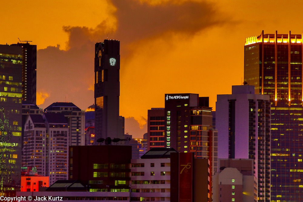 02 MAY 2013 - BANGKOK, THAILAND:   Lights come on in the skyscrapers as the sunsets over the city of Bangkok, the capital of Thailand.    PHOTO BY JACK KURTZ