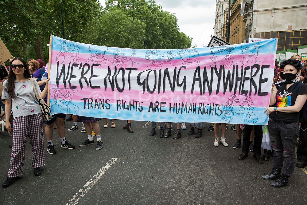Protesters hold a banner as thousands of people take part in a London Trans+ Pride march from the Wellington Arch to Soho Square on 26th June 2021 in London, United Kingdom. London Trans+ Pride is a grassroots protest event which is not affiliated with Pride in London and focuses on creating a space for the London trans, non-binary, intersex and GNC community to come together to celebrate their identities and to fight for their rights.