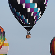 Rupert Stanley, UK, (centre) in action during practice day for the World Hot Air Ballooning Championships in Battle Creek, Michigan, USA. 17th August 2012. Photo Tim Clayton
