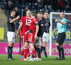 Falkirk's David McCracken and Ref Bobby Madden point to Ayr United's Nicky Devlin after he fell to the ground. Falkirk 1 v 1 Ayr United, Scottish Championship game played 14/1/2017at The Falkirk Stadium .