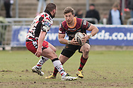 Carl Meyer of the Newport Gwent Dragons takes on Rory Sutherland of Edinburgh rugby. Guinness Pro12 rugby match, Newport Gwent Dragons v Edinburgh Rugby at Rodney Parade in Newport, South Wales on Sunday 27th March 2016.<br /> pic by  Simon Latham, Andrew Orchard sports photography.