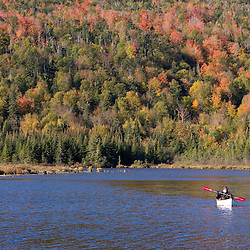 A canoer on a part of the Connecticut River called the Moose Flowage in Pittsburg, New Hampshire.  Between Second and Third Connecticut Lakes.