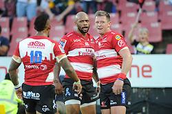070418 Emirates Airlines Park, Ellis Park, Johannesburg, South Africa. Super Rugby. Lions vs Stormers. Elton Jantjies walks towards his backline team mates Lionel Mapoe and Ruan Combrinck after Mapoe scored a try.<br />Picture: Karen Sandison/African News Agency (ANA)