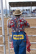 Rodeo clown takes a break between the action.