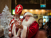 17 SEPTEMBER 2015 - BANGKOK, THAILAND:  A Santa Claus applauds during the World Santa Claus Congress in Bangkok. Twenty-six Santa Clauses from around the world are in Bangkok for the first World Santa Claus Congress. The World Santa Claus Congress has been an annual event in Denmark since 1957. This year's event, hosted by Snow Town, a theme park with a winter and snow theme, hosted the event. There were Santas from Japan, Hong Kong, the US, Canada, Germany, France and Denmark. They presented gifts to Thai children and judged a Santa pageant. Thailand, a Buddhist country, does not celebrate the religious aspects of Christmas, but Thais do celebrate the commercial aspects of the holiday.   PHOTO BY JACK KURTZ
