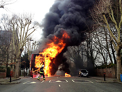 © London News Pictures. 17/03/2012. London, UK. Firemen at the scene where a double-decker bus exploded into flames on Pepys Road in Brockley, South East London on March 17th, 2012. Everyone on the bus escaped the incident unharmed, despite the fire also causing two cars parked nearby to burst into flames. Photo credit : Jason Cuddy/LNP.