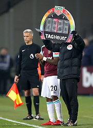 A Rainbow coloured substitution board is shown as West Ham United's Andre Ayew replaces team mate Marko Arnautovic