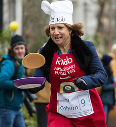 MPs and members of the House of Lords compete in the annual Rehab pancake race, a relay of eleven laps in Victoria Tower Gardens adjacent to the Houses of Parliament in London. The race is held every year on Shrove Tuesday and was won by the Media team. PICTURED: Jo Coburn from BBC Daily Politics. London, February 13 2018.
