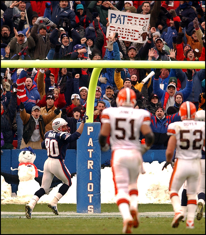 (12/09/01 Foxboro, MA.) New England Patriots vs Clevland. Even the Snowman is smiling as Troy Brown heads into the endzone on his 85yard TD return in the 2nd. (120901patsmjs-Staff Photo by Michael Seamans. Saved in Photo mon.)