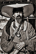 Mountain Man outfitted in his Taos style garb at Historic Fort Bridger.
