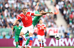 Saudi Arabia's Abdullah Otayf and Russia's Roman Zobnin (left) battle for the ball during the FIFA World Cup 2018, Group A match at the Luzhniki Stadium, Moscow.