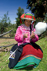Woman in traditional clothing spinning wool, Vicos, Peru, South America  MR