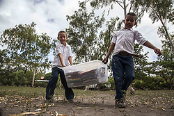 April 23, 2017 - Rural Village, Nicaragua - The Flying Book is a social project that aims to be an important mechanism for the education and development of urban and rural communities of Nicaragua, through a mobile library service that provides inclusive and alternative information. The library bus makes two visits per month to each rural school and lends books to children and teachers in rural schools to take home, providing the opportunity to access more information within their community and preventing the movement of students to other communities due to a lack of materials available to accomplish tasks and assignments. There are also a number of activities aimed at promoting reading for pleasure, through different themes: environment, care of books, the importance of reading, puppets, plays and Kamishibai etc.It also aims to reach the wider community with the aim of providing information to facilitate individual development and through this resolve family and community issues. (Credit Image: © Alvaro Fuente/NurPhoto via ZUMA Press)