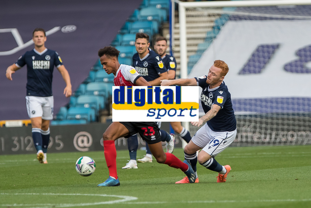 Football - 2020 / 2021 EFL Cup - Round Two - Millwall vs Cheltenham Town<br /> <br /> Elliot Bonds (Cheltenham Town) nips in and takes the ball from Ryan Woods (Millwall FC) at The Den.<br /> <br /> COLORSPORT/DANIEL BEARHAM