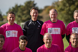 © Licensed to London News Pictures . 28/09/2014 . Birmingham , UK . Health Secretary JEREMY HUNT serves as linesman during the match posing with Conservative Party team before the match - they're wearing pink in support of Breast Cancer Care . Conservative Party vs Journalists football match at a Birmingham University football pitch , at the start of the conference . The 2014 Conservative Party Conference in Birmingham . Photo credit : Joel Goodman/LNP