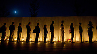 Shanksville, PA  -- People stand as 40 luminaria are carried away from the Flight 93 Memorial Wall of Names after being lit and place on the evening of Tuesday, September 10, 2013, one candle for each passenger or flight crew member aboard United Flight 93 on September 11, 2001. The memorial honors the 40 passengers and crew of United Flight 93 who lost their lives in disrupting the attack on the nationís capital on September 11, 2001. -- Photo by Jack Gruber, USA TODAY