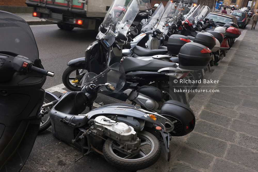 Fallen over motorbike in line of mopeds on Florence street.