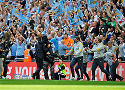 14.05.2011, Wemblay Stadium, ENG, FA CUP FINALE, Manchester City vs Stoke City im Bild Attilio Lombardo  jumps onto manager Roberto Mancini at the final whistle..Manchester City v Stoke City,. FA Cup Final,.Wembley Stadium. London. UK. .14/05/11, EXPA Pictures © 2011, PhotoCredit: EXPA/ IPS/ S. Ryan *** ATTENTION *** UK AND FRANCE OUT!