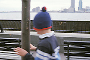 boy walking with hat pulled over eyes