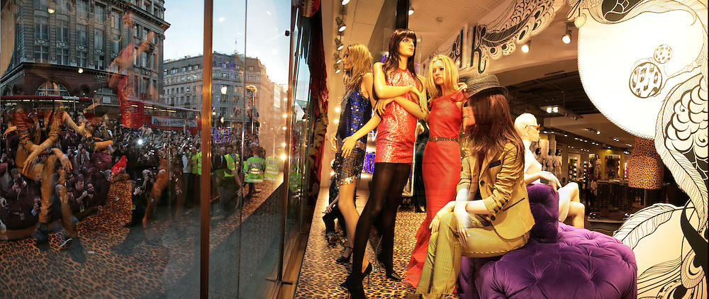 Stitched panoramic photograph of Kate Moss in the window, Launch of the Kate Moss collection. Top Shop. Oxford St. London. 30 April 2007.   -DO NOT ARCHIVE-© Copyright Photograph by Dafydd Jones. 248 Clapham Rd. London SW9 0PZ. Tel 0207 820 0771. www.dafjones.com.