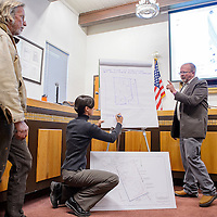 031314       Cable Hoover<br /> <br /> DOT engineer Mark Fahey and environmental consultant Christina Kelso make notes about design changes proposed by Tony Tanner, right, and Fitz Sargent, left, during a meeting at City Hall Thursday.
