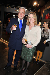DAVID McDONOUGH and LADY MARY-GAYE CURZON at a party to celebrate the publication of Folly de Grandeur: Romance and Revival in an English Country House by Nicky Haslam held at Oka, 155-167 Fulham Road, London on 21st March 2013.