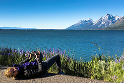 Lara Heimert photographing wildflowers in Grand Teton National Park.  Now this isn't that way I would get low enough to capture the wildflowers; however, it seemed to work for Lara.