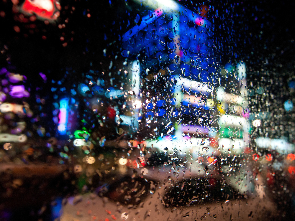 Daegu/South Korea, Republic Korea, KOR, 07.09.2010: Street life during rain seen from a bus in the South Korean city of Daegu.