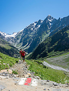 Kandersteg is a great base for hiking in Switzerland. For example: an epic hike from Selden in Bern canton traverses Lötsch glacier and Lötschen Pass (German: Lötschenpass, Swiss German: Lötschepass) to neighboring Lötschental in Valais canton; hiking poles recommended. The walk starts with a reserved Postbus ride from Kandersteg to Selden (in Gasterntal / Gasteretal / Gasterental), climbs 1350 meters, descends 925 m, and ends 13 km later at Lauchernalp lift station, which descends to Wiler in Lötschental, to reach Goppenstein via Postbus, back to Kandersteg via train. You can also reverse the route or stay overnight in dorms at Lötschepass hut. This image was stitched from multiple overlapping photos.