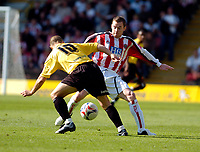 Photo: Leigh Quinnell.<br /> Watford v Sheffield United. Coca Cola Championship.<br /> 17/09/2005. Sheffield Uniteds Alan Quinn cant find a way past Watfords Paul Devlin.