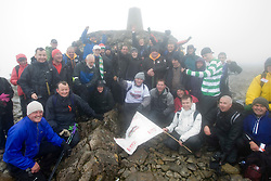 John with some of the walkers at the top..The John Hartson Foudation walk up Ben Nevis..Pic ©2010 Michael Schofield. All Rights Reserved.