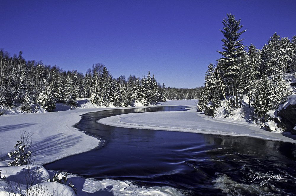 Open water above rapids on the Wanapitei River in winter, Wanup, Ontario, Canada