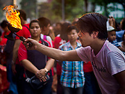19 OCTOBER 2018 - BANGKOK, THAILAND: A man uses a pot of fire for prayer during Navratri celebrations in Bangkok. Navratri is a nine night (10 day) long Hindu celebration that marks the end of the monsoon and honors of the divine feminine Devi (Durga). The festival is celebrated differently in different parts of India, but the common theme is the battle and victory of Good over Evil based on a regionally famous epic or legend such as the Ramayana or the Devi Mahatmya. Navratri is celebrated throughout Southeast Asia in communities that have a large Hindu population.   PHOTO BY JACK KURTZ