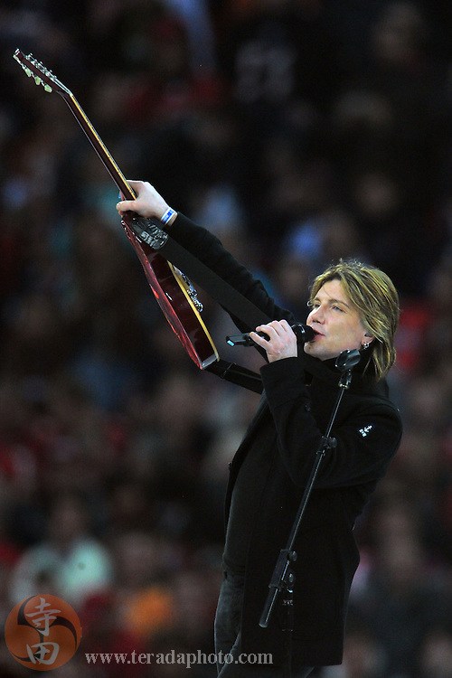 October 23, 2011; London, ENGLAND; Recording artist Goo Goo Dolls band member John Rzeznik performs before the NFL International Series game between the Tampa Bay Buccaneers and the Chicago Bears at Wembley Stadium. The Bears defeated the Buccaneers 24-18.