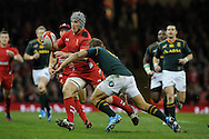 Jonathan Davies of Wales looks to break through.  Autumn International rugby, 2013 Dove men series, Wales v South Africa at the Millennium Stadium in Cardiff,  South Wales on Saturday 9th November 2013. pic by Andrew Orchard, Andrew Orchard sports photography,